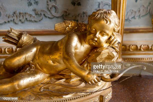 Sleeping cupid sculpture on a console table interior decoration of the reception hall apartment of the Duke of Chablais Hunting residence by Filippo...