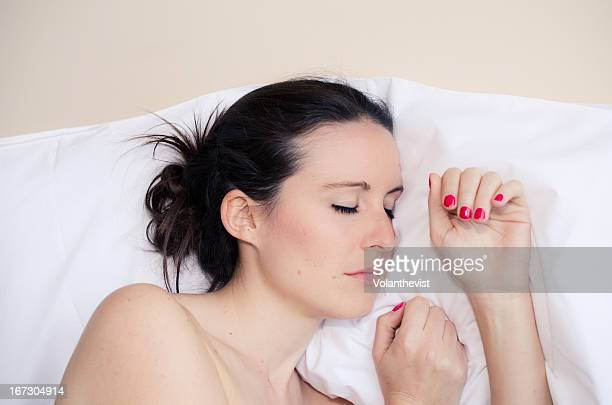 Sleeping girl w/ white skin and hair tied up