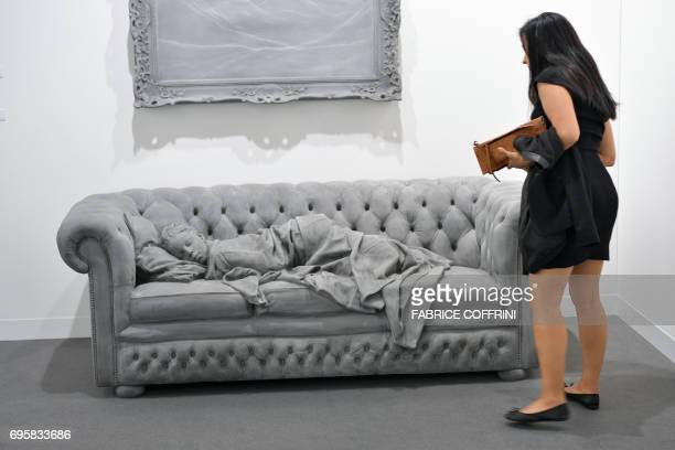 'Sleeping girls' by Belgian visual artist Hans Op de Beeck is displayed at Galerie Krinzinger's stand during the preview day of Art Basel the world's...
