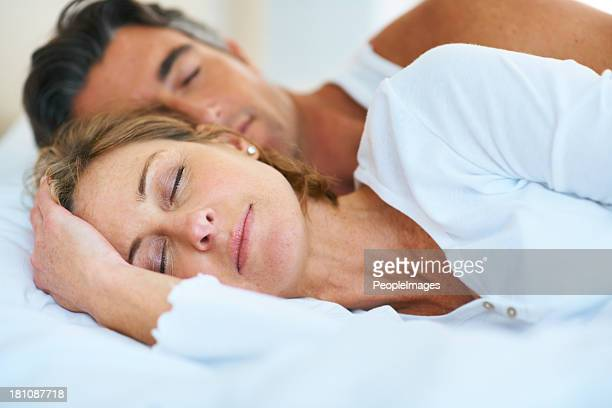 sleeping in late - couple sleeping stock pictures, royalty-free photos & images