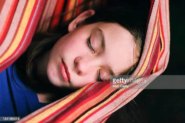 Sleeping in striped hammock
