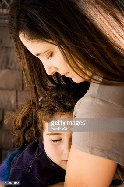 Sleeping Little Girl in Mother's Arms