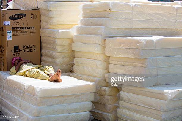 stack of mattresses. Pile Of Old Mattresses. RF. Editorial Use Only. Sleeping Man Stack Mattresses