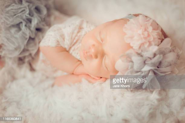 sleeping newborn baby girl wearing funny outfit - princess stock pictures, royalty-free photos & images