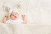 http://www.istockphoto.com/photo/sleeping-newborn-baby-in-woolen-hat-new-born-kid-sleep-on-bed-blanket-gm943678700-257820900