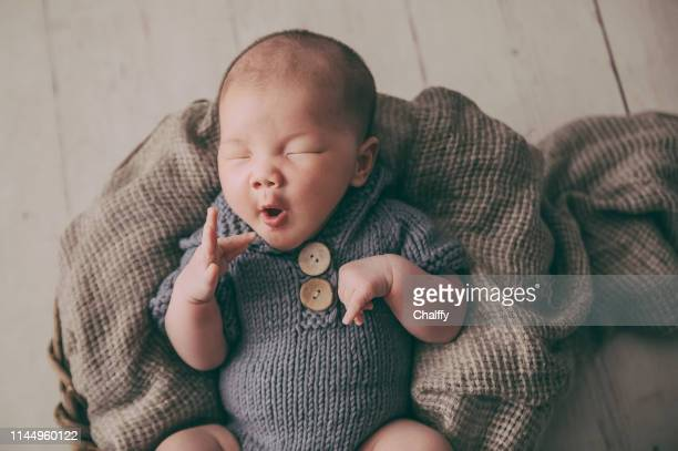 sleeping newborn baby - baby boys stock pictures, royalty-free photos & images