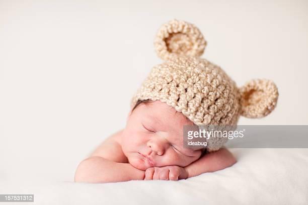 Sleeping Newborn Baby Wearing Knit Hat with Bear Ears