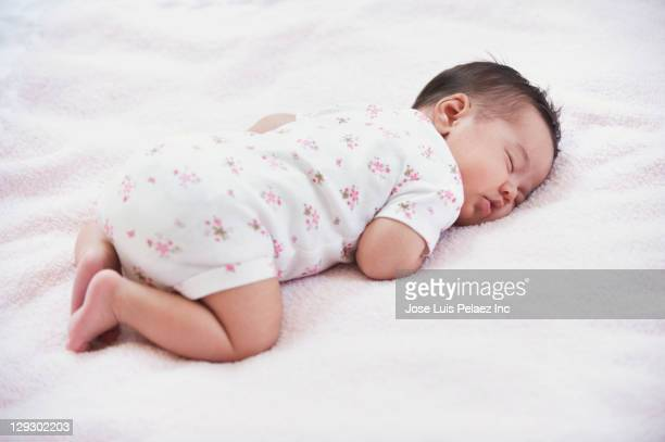 sleeping newborn mixed race baby girl - baby onesie stock photos and pictures