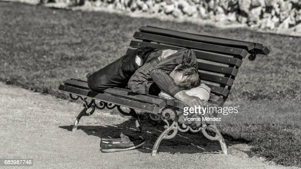 Sleeping on a bench in the sun