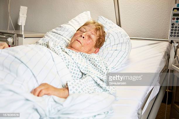 sleeping senior woman in hospital - old woman in sick bed stock photos and pictures