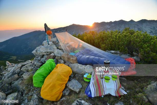 sleeping under the stars, bivouac at mountain peak at sunrise - mosquito net stock photos and pictures