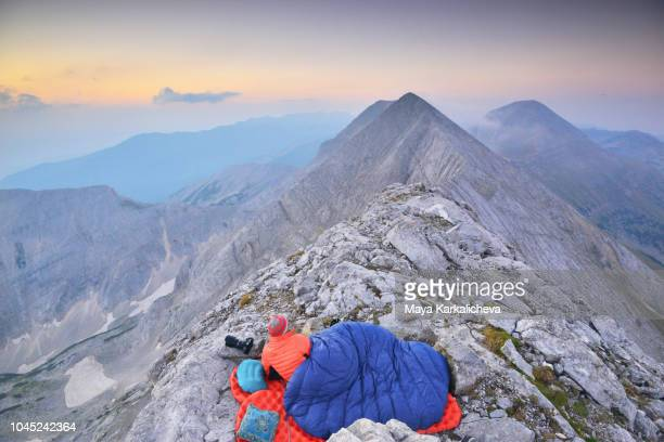 sleeping under the stars, man waking up on top of a mountain - pirin mountains stock pictures, royalty-free photos & images