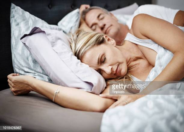 sleeping with someone is the best kinda sleep - couple sleeping stock pictures, royalty-free photos & images