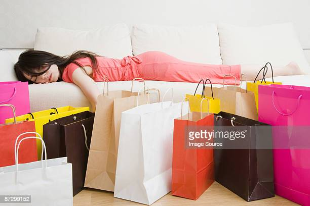 sleeping woman and shopping bags - large group of objects stock pictures, royalty-free photos & images