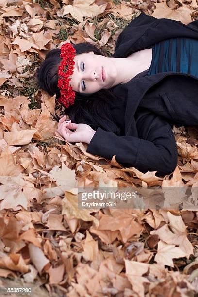 Sleeping Woman Lying in Autumn Leaves