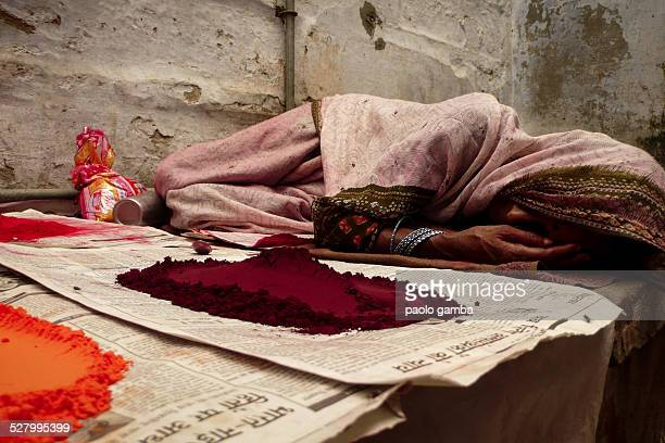 Sleeping woman next to curry and other spicy powder in a street of Benares/Varanasi India 2008