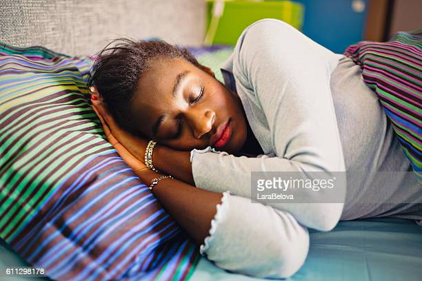 Sleeping young African woman