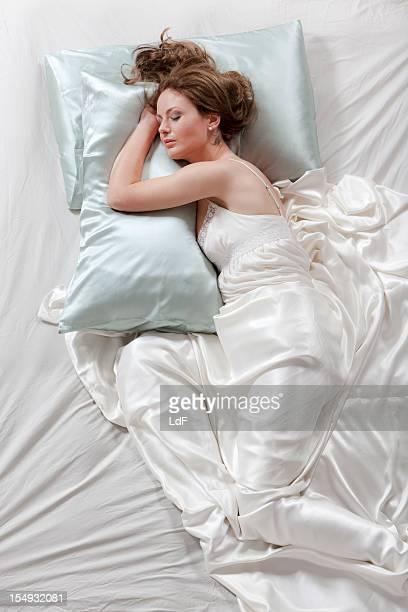 Sleeping young wooman, high angle view