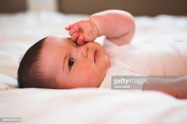 sleepy baby rubbing eyes - conjunctivitis stock pictures, royalty-free photos & images