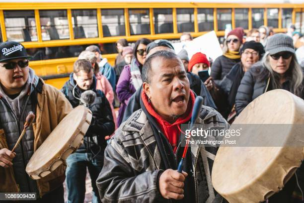 Sleepy Eye LaFromboise beat a drum in front of Nathaniel Hall a diocese member who was praying to a rosary at a protest outside the Covington...