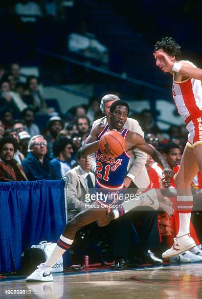 Sleepy Floyd of the New Jersey Nets dribbles the ball against the Atlanta Hawks during an NBA basketball game circa 1982 at the Capital Centre in...