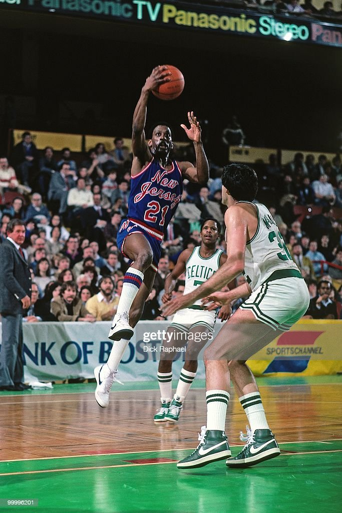 Sleepy Floyd #21 of the New Jersey Nets shoots a layup against Kevin McHale #32 of the Boston Celtics during a game played in 1983 at the Boston Garden in Boston, Massachusetts.