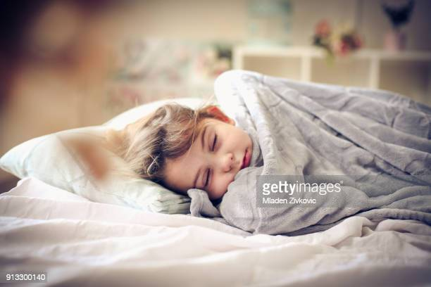 sleepy little girl. - blanket stock pictures, royalty-free photos & images