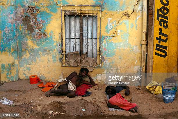 Sleepy workers in a street of Chennai. A colorful setting.