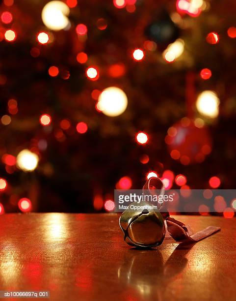 Sleigh bell  on table in front of Christmas tree