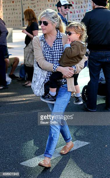 Slema Blair and her son Arthur Bleick are seen at the Studio City Farmers Market on December 22 2013 in Los Angeles California