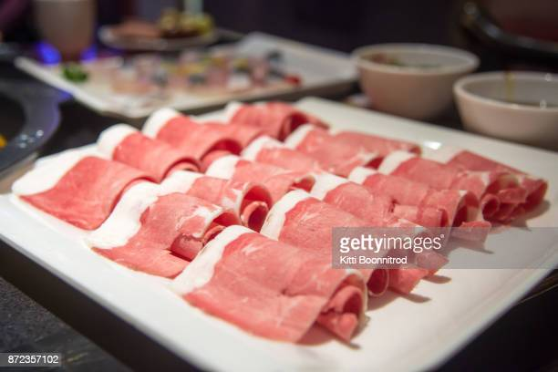 Slice beef meat for Chinese hot pot, one of famous Chinese food