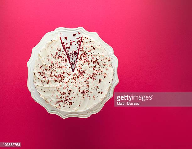 slice missing from chocolate cake on cakestand - chocolate cake above stock pictures, royalty-free photos & images