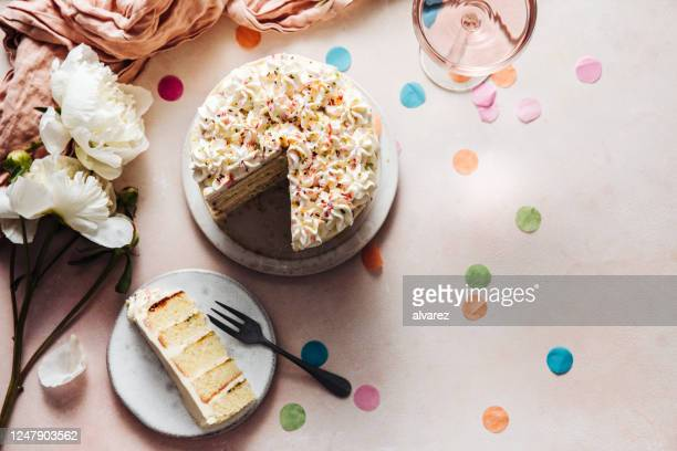 slice of a birthday cake on plate - confetti stock pictures, royalty-free photos & images