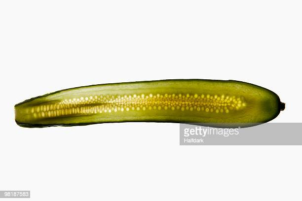 A slice of a pickle on a lightbox