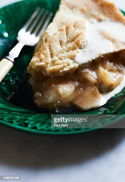 slice of apple pie and cream