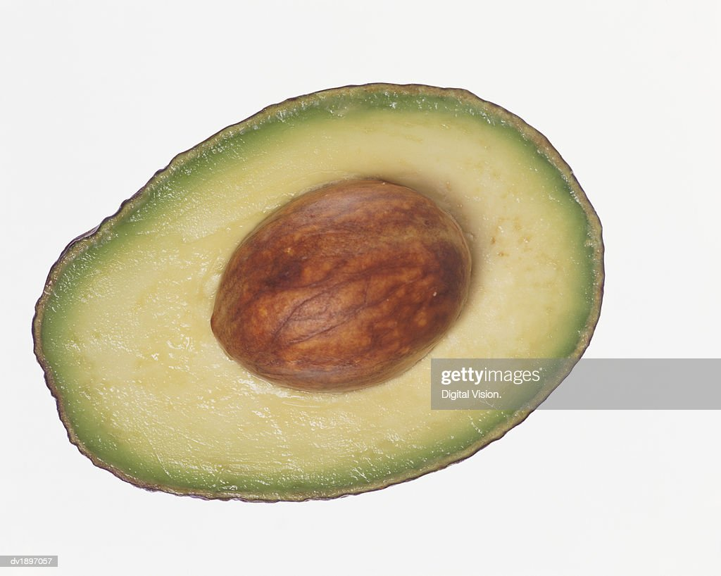 Slice of Avocado Containing a Seed : Stock Photo