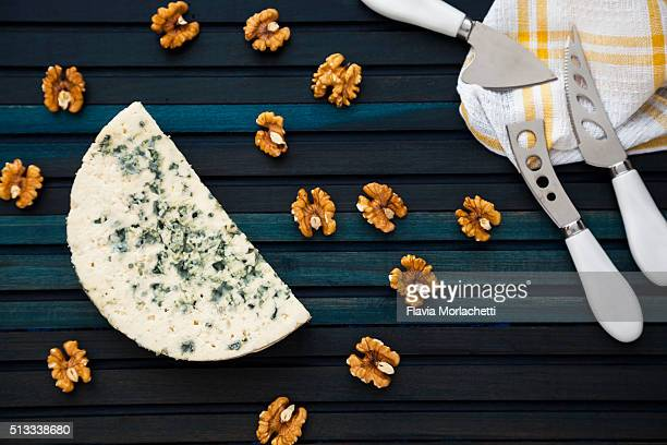 A slice of blue cheese and walnuts