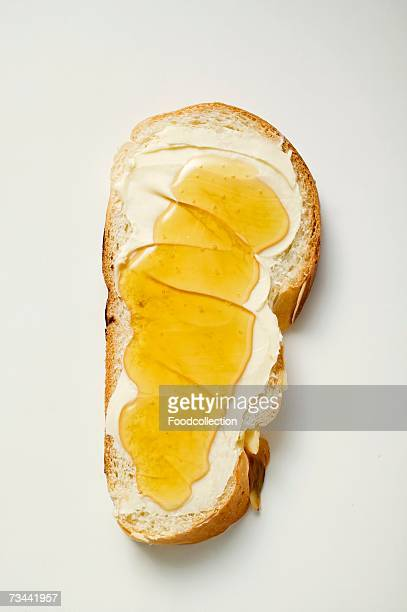 Slice of bread plait with butter and honey