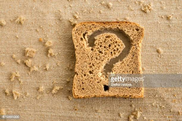 A slice of bread toast with a question mark