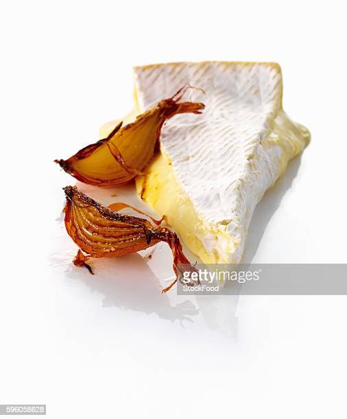 A slice of brie and caramelized onions