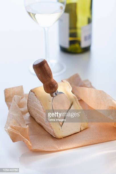 Slice of brie with cheese knife
