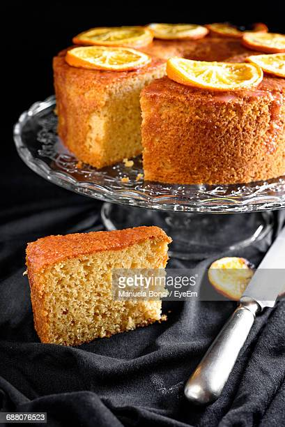 Slice Of Cake By Stand On Table