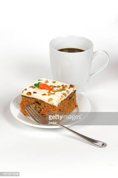 Slice of carrot cake, coffee, and a fork