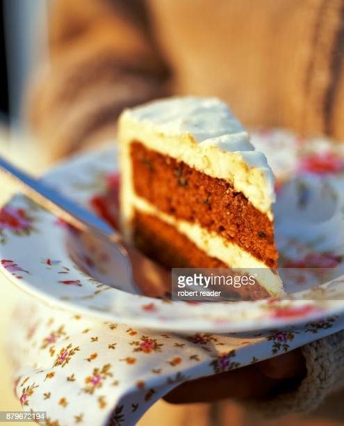 Slice of carrot cake on floral plate
