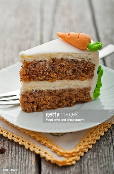 slice of carrot cake - carrot cake stock pictures, royalty-free photos & images