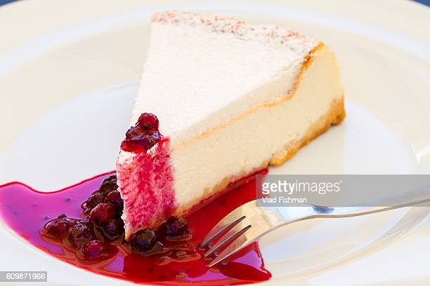 Slice of cheese cake on a white plate