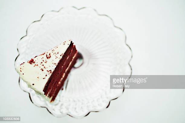 Slice of chocolate cake on cakestand