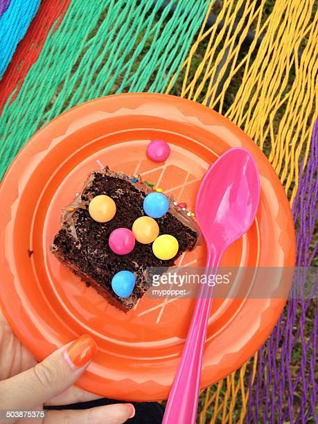 slice of chocolate cake on plastic plate - plastic plate stock photos and pictures