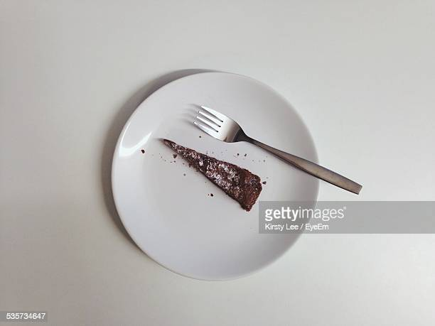 slice of chocolate cake on plate - chocolate cake above stock pictures, royalty-free photos & images