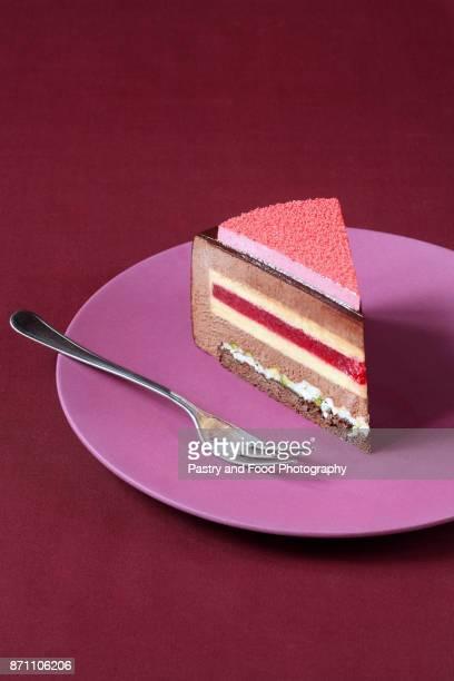 slice of chocolate raspberry mousse cake - capas superpuestas fotografías e imágenes de stock